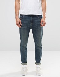 Asos Relaxed Tapered Jeans In Dark Blue Wash Dark Blue