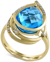 Effy Collection Ocean Bleu By Effy Blue Topaz 6 5 8 Ct. T.W. And Diamond 1 8 Ct. T.W. Orbit Ring In 14K Gold