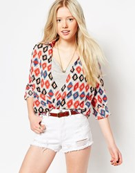 Jasmine Wrap Front Blouse In 70S Print Red