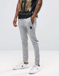 Religion Jersey Joggers In Slim Fit With Metal Badge And Zip Cuff Grey Marl