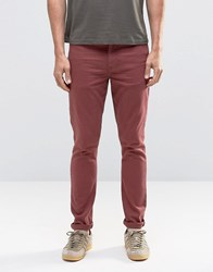 Asos Super Skinny Jeans In Burgundy Oxblood Red