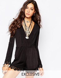 Rokoko Sexy Plunge Neck Playsuit With Lace Hem Detail Black