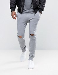 Asos Super Skinny Joggers With Knee Rip In Grey Elephant Grey