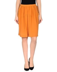 Uniqueness Knee Length Skirts Orange