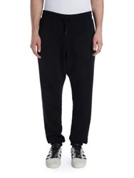 Off White Solid Cotton Jogger Pants Black