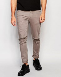 Asos Super Skinny Jeans With Knee Rips In Grey Grey