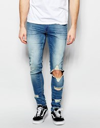 Asos Extreme Super Skinny Jeans With Extreme Rips Blue