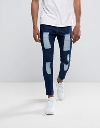 Illusive London Super Skinny Jeans In Dark Wash Blue With Distressing Blue