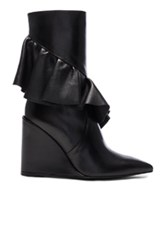 J.W.Anderson J.W. Anderson Mid Calf Leather Ruffle Boots In Black