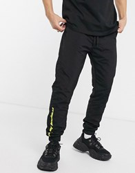 Criminal Damage Nylon Joggers In Black With Neon Logo