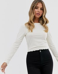 New Look Long Sleeve Crop Frill Hem Top In Off White Cream