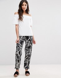 Girls On Film Print Peg Trousers Black White