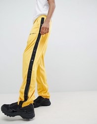 Mennace Jogger In Gold With Press Studs Yellow