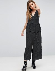 Asos Jumpsuit In Spot With Peplum Ruffle Detail Black And White