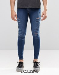 Cheap Monday Low Spray Slash Extreme Super Skinny Jeans In Mid Blue Extreme Rips Mid Blue