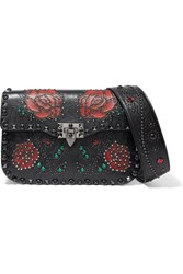 Valentino Garavani The Rockstud Rolling Embellished Textured Leather Shoulder Bag Black