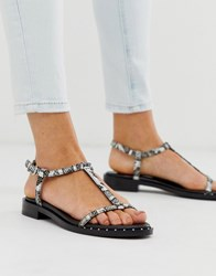 Bronx Leather Strappy Sandals In Black And White Snake