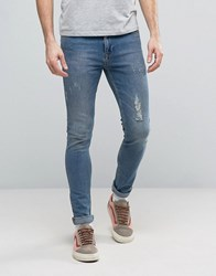 Asos Super Skinny Jeans With Rips And Abrasions In Vintage Mid Wash Mid Blue
