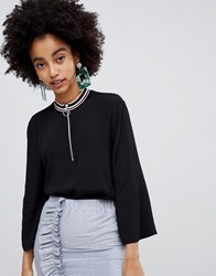 Soaked In Luxury High Neck Zip Front Top With Tipping Black