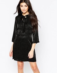 Liquorish Pussybow Dress With Mini Cape In Tonal Leopard Jacquard Black