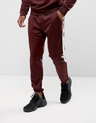 Illusive London Skinny Track Joggers In Burgundy With Taping Red