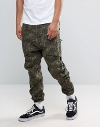Asos Drop Crotch Cargo Floral Joggers In Khaki Khaki Green