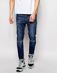 Asos Super Skinny Jeans With Knee Rips Blue