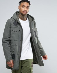 Asos Parka With Allover Patches In Khaki Khaki Green