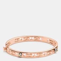 Coach Daisy Rivet Pierced Kissing C Hinged Bangle Rosegold
