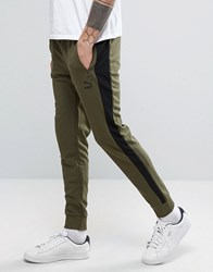 Puma Tapered Joggers In Green Green