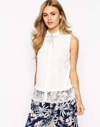 Dahlia Sleeveless Blouse With Tie Neck And Lace Hem Cream