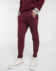 Converse Made In Italy Reverse Fleece Logo Cuffed Joggers In Burgundy Red