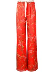 Alexis Floral Print Palazzo Trousers Yellow Orange