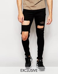 Reclaimed Vintage Super Skinny Jeans With Large Knee Rips Black