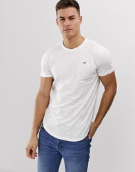 Hollister Icon Logo Curved Hem T Shirt In White