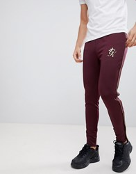 Gym King Skinny Joggers In Burgundy With Gold Piping Red