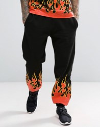 Granted Cuffed Joggers In Black With Flames Black