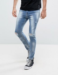 Asos Super Skinny Jeans With Bleach Spot And Rips Light Wash Blue
