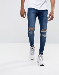 Illusive London Muscle Fit Jeans In Mid Wash Blue With Distressing