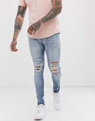 New Look Ripped Super Skinny Jeans In Light Wash Blue