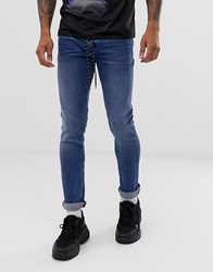 Armani Exchange J14 Stretch Skinny Fit Jeans In Mid Wash Blue