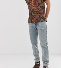Heart And Dagger Distressed Jeans In Mid Blue