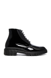 Saint Laurent Patent Leather Army Boots In Black