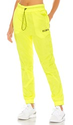 Puma Chase Woven Pant In Yellow. Yellow Alert
