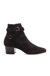 Saint Laurent Wyatt Suede Buckle Boots In Black
