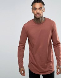 Asos Relaxed Longline Long Sleeve T Shirt With Curve Hem In Rust Red
