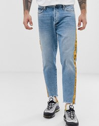 Jack And Jones Intelligence Tapered Fit Jeans With Slogan Taping Blue
