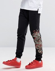 Criminal Damage Joggers With Dragon Print Black