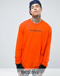 Reclaimed Vintage Oversized Long Sleeve T Shirt With Sinister Print Orange