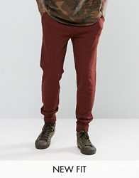 Asos Skinny Joggers In Dark Red Chestnut